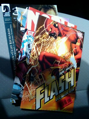 Comic stack topped with Flash: Rebirth #1